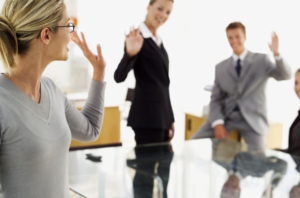 businesswoman greeting other executives